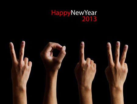 The number 2012 shown by fingers in creative New Year greeting card photo