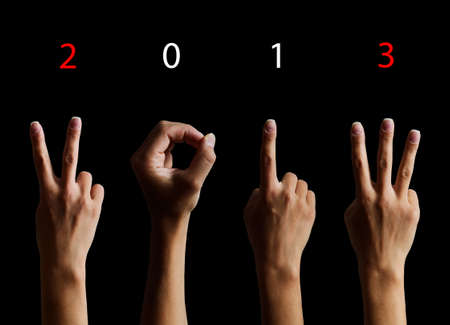 The number 2012 shown by fingers in creative New Year greeting card Stock Photo - 15826010