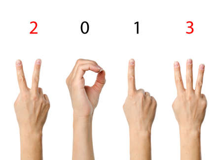 The number 2013 shown by fingers in creative New Year greeting card Stock Photo - 15842082