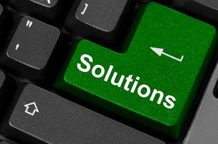 Computer keyboard - green key Solutions, closeup  photo