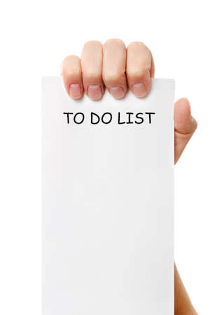 Hand was holding of a to do list paper note isolated on white background Stock Photo - 16953095