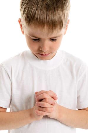 evangelism: Little boy praying - closeup isolated on white background Stock Photo