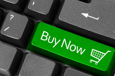 sell shares: Buy now concepts, with message on computer keyboard.