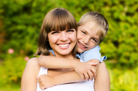 country boy: Happy mother and son laughing together outdoors Stock Photo