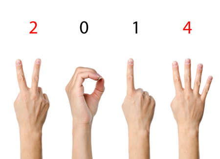 0 1 year: The number 2014 shown by fingers in creative New Year greeting card