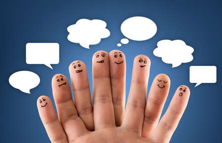 Happy group of finger smileys with social network sign and icons on blue