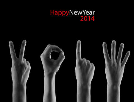 The number 2014 shown by fingers in creative New Year greeting card