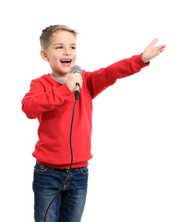 Little boy with microphone sings a song. Isolated on a white background Standard-Bild