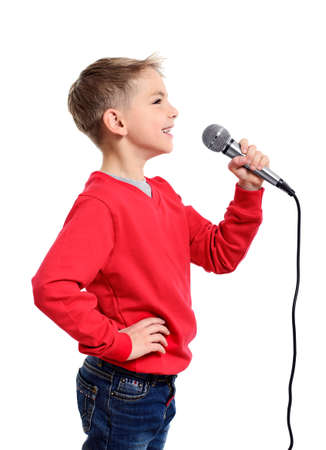 Little boy with microphone sings a song. Isolated on a white background Stock Photo