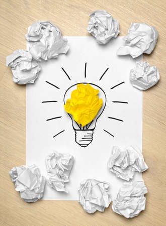 crumpled paper ball: Light bulb crumpled paper as creative concept Stock Photo