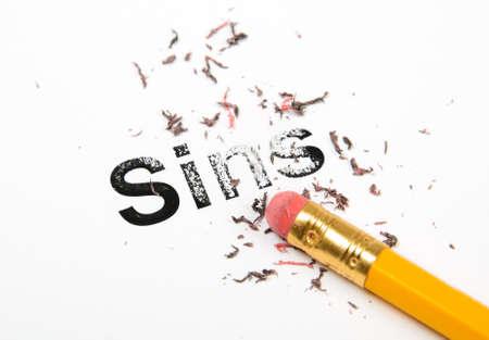 Erasing Sins with a rubber eraser concept