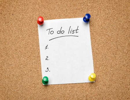to do list: A To Do List pinned to a cork notice board as an aid to efficiency and productivity