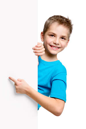 kid pointing: Portrait of happy little boy with white blank isolated on white background Stock Photo
