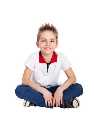 Young man sitting on the floor isolated on white background