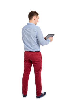 using tablet: Back view of standing young men and using a tablet. Backside view of person. Isolated over white background