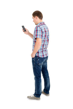 black and white photograph: Back view of standing young men and using a mobile phone. Rear view people collection. Backside view of person. Isolated over white background