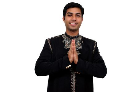 namaste: Indian in traditional clothes in namaste pose (1) with clipping path Stock Photo