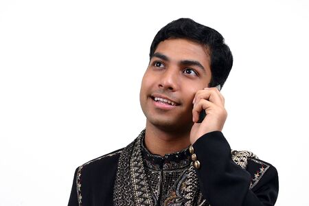 kurta: Indian in traditional clothes speaking in the phone (1) with clipping path