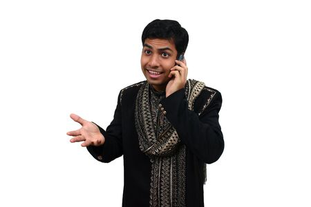 kurta: Indian in traditional clothes speaking in the phone (3) with clipping path