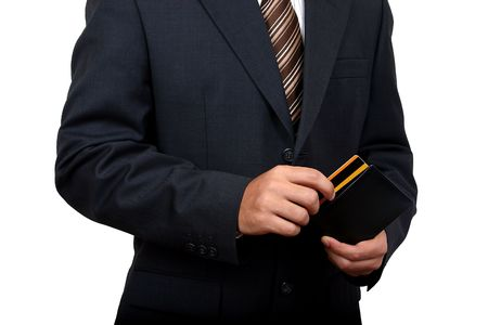 Business man taking out his credit card (2) with clipping path Stock Photo - 936957