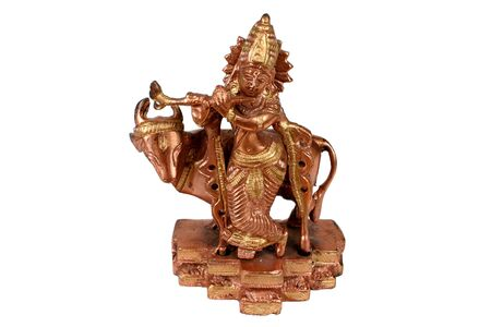 A metal figure of Hindu God Krishna photo