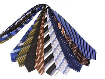 formality: Lots of ties isolated over white.