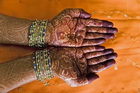 Hands of a Indian bride with henna design and bangles photo