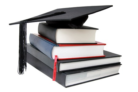 A Graduation mortar on top of books photo