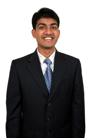 optimist: Young Indian business man smiling Stock Photo