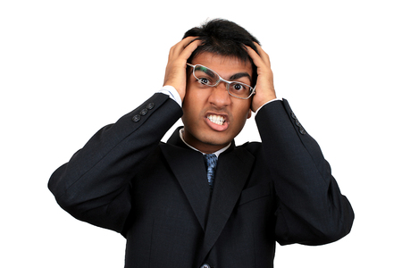 Young Indian business man in confused pose photo
