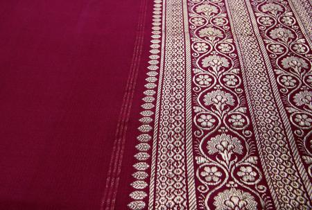 Closeup of golden embroidery on Indian saree. photo