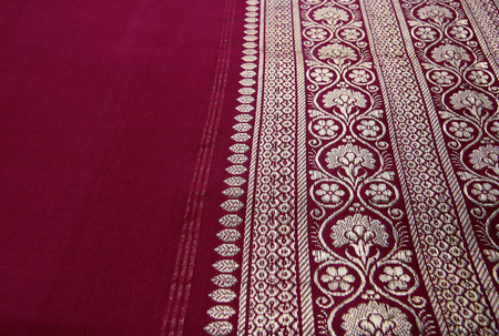 sari: Closeup of golden embroidery on Indian saree. Stock Photo