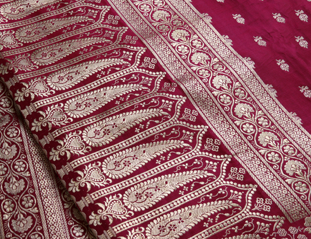 silk thread: Closeup of golden embroidery on Indian saree. Stock Photo