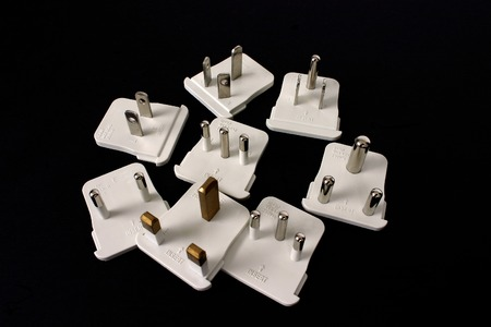 adapters: Travel adapters isolated on black background