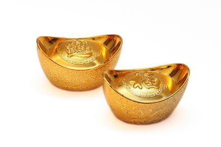 chinese gold ingots isolated over white background Stock Photo