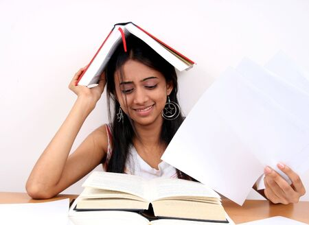 coursework: Indian student preparing for exams. Stock Photo