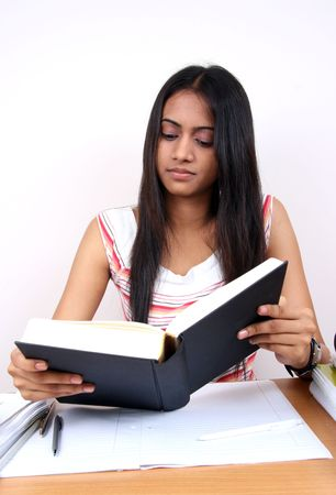 revise: Indian student preparing for exams. Stock Photo