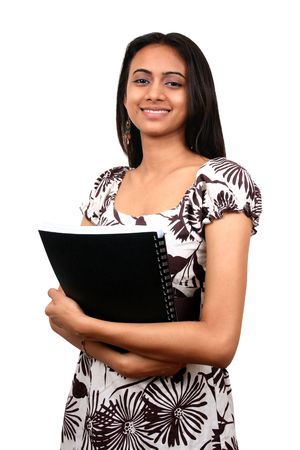 Indian student with books in hand, isolated over white background. photo