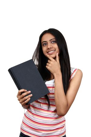 fresh graduate: Young Indian student holding a book. Stock Photo
