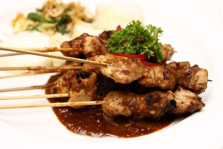 Close-up of delicious Indonesian chicken satay.