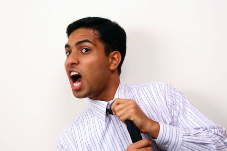 unsatisfied: Indian Business man screaming with frustration. Stock Photo
