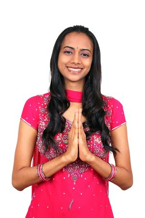 A beautiful young Indian girl in namaste pose. photo