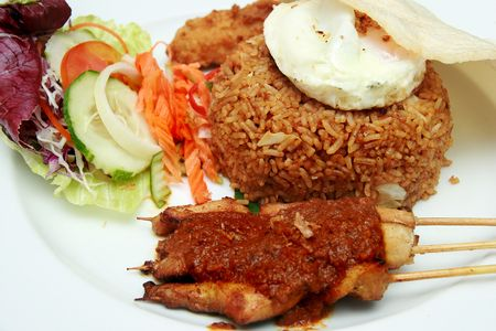 sunnyside: Delicious Indonesian Nasi Goreng with prawn crackers and chicken satay Stock Photo