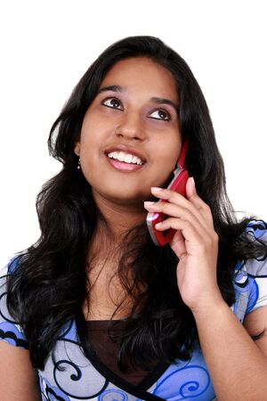 pakistani: Young asian girl talkin in phone. Isolated on white.