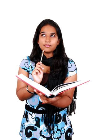 Young Asian student with a book in hand. Isolated on white. Stock Photo - 4077483
