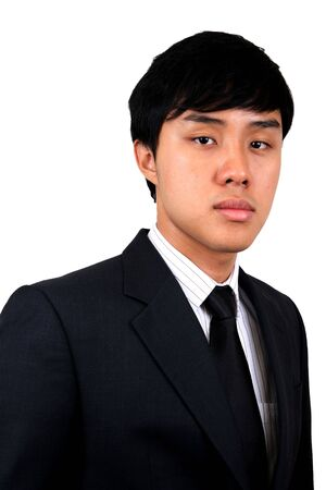 Young and confident Asian business man. Isolated on white. photo