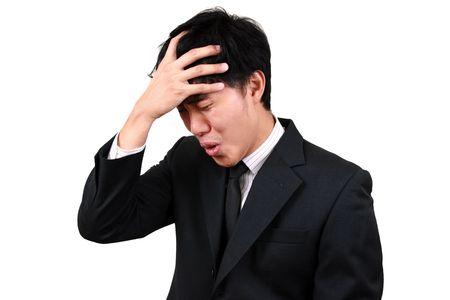 panique: Jeunes asiatiques a soulign� l'homme d'affaires. Banque d'images