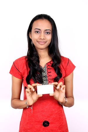 publicize: Beautiful Indian girl holding a white banner. Stock Photo