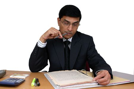 Indian business man working at his desk photo