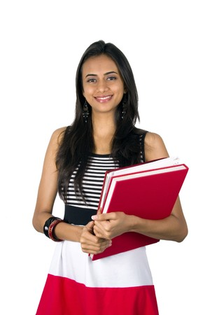 indian college student: Young teenage girl holding books. Isolated on a white background.